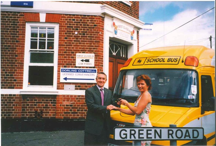 Martin handing the keys over to one of our first customers First Class Day Nursery in 2001